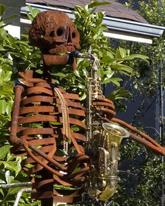 A Dead Head of a sax player... This 6+foot statuesesque skeleton stands on the steepest hill Berkeley has to offer.  A great tribute to sax players everywhere.