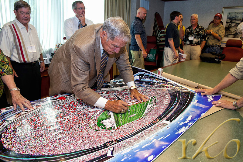 Coach Gene Stallings autographing 44x66 print for RKO Photography