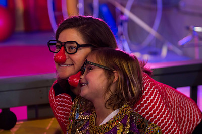 A mom and daughter posing in the mirror during a surprise 40th birthday party at Circus Mojo in Latonia Kentucky.