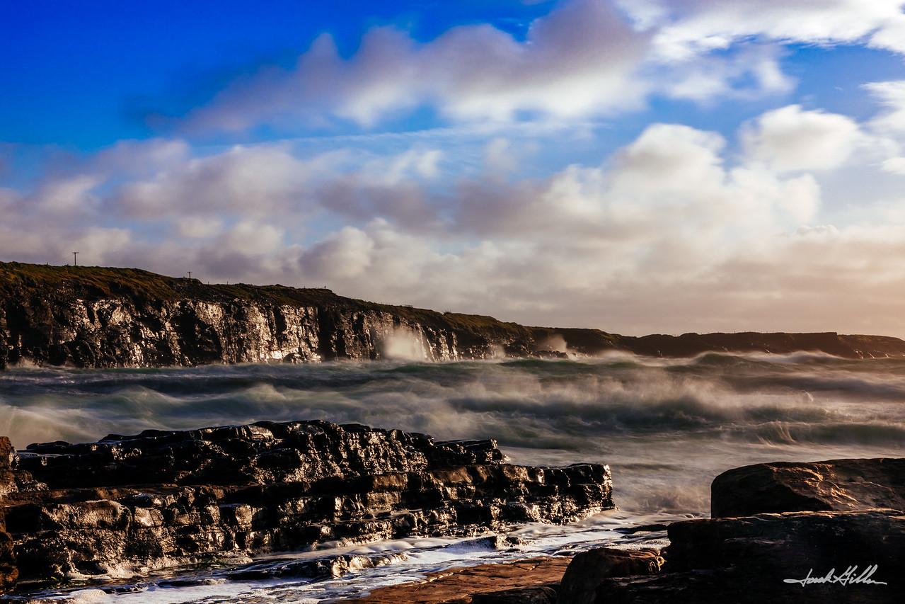 Crashing, misty waves at sunset