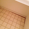 Before Photo: Hall bath.  The flooring under the vanity counter was not installed properly.