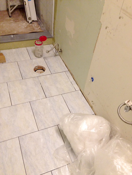 2018-02-21 (Day 7): Master bath.  Floor almost finished.