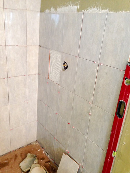 2018-02-20 (Day 6): Master bath. Shower wall tiles installed.  Faucet control hole.