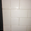 2018-03-02 Hall Bath.   Close up of tile installed on back wall of tub at botom.