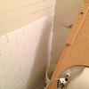 2018-02-28 (Day 12): Hall Bath. Subway tile wainscot along back wall.