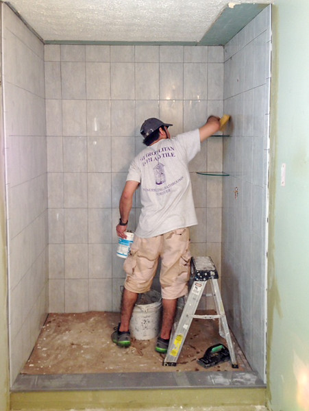 2018-02-21 (Day 7): Master bath.  Shower being grouted.