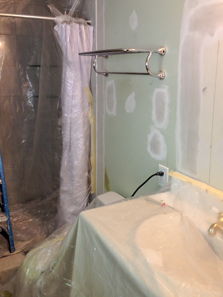 2018-03-06 Master Bath.  Kelvis, drywall specialist, preparing protection before fixing the walls.