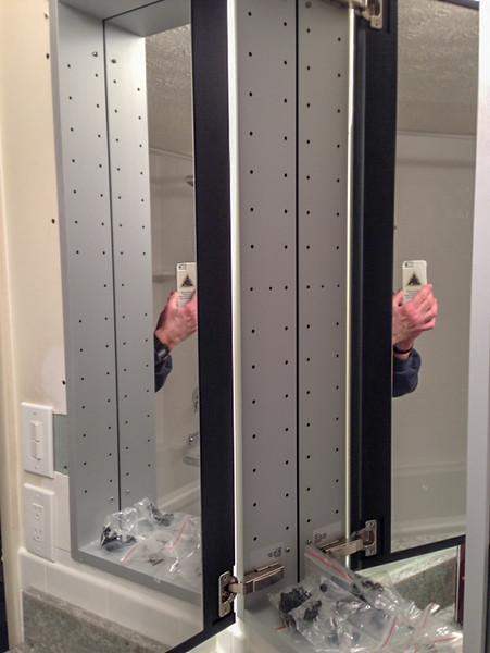 2018-03-09 Hall Bath.  Medicine cabinet showing mirrored inside of door.