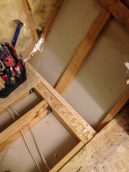 2018-02-14 (Day 2): Master bath.  Stairwell ceiling meets shower wall.