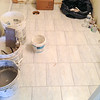 2018-02-28 (Day 12): Hall Bath.  Floor tiles have been grouted.