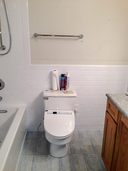 2018-03-05 Hall Bath.  Towel bar installed (but not centered over toilet).