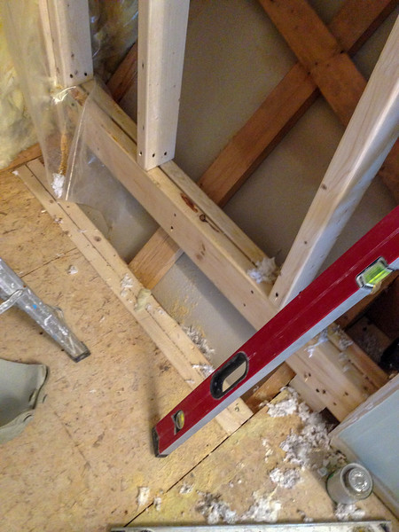 2018-02-15 (Day 3): Master bath. Support beam installed for expanded shower wall.