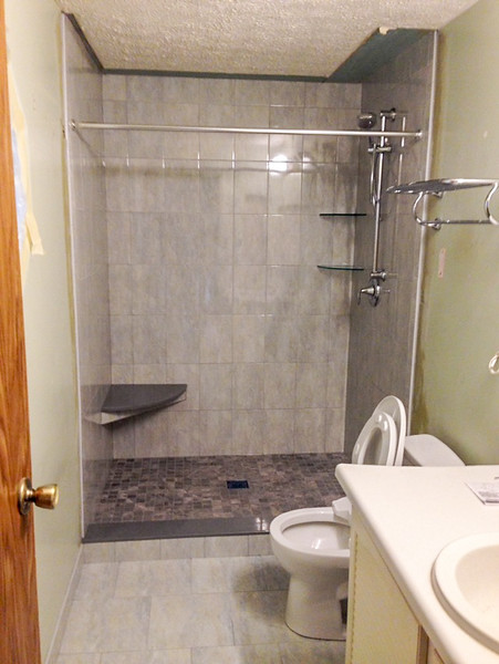 2018-02-23 (Day 9): Master bath.  Shower completed, toilet installed, temporary vanity/sink installed.
