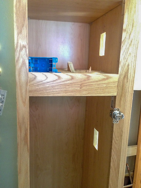 2018-03-01 (Day 13): Master Bath.  Holes in cabinet for electrical outlets.