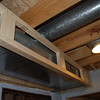 Ductwork above the stairway closet.