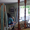 Installing the sliding glass door frame.