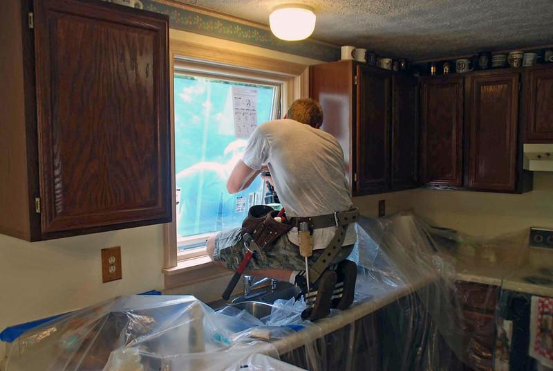 Installing the kitchen sink window.