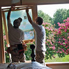 Installing windows in master bedroom.