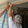 Installing the frame for the sliding glass door.