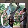 Installing windows in master bedroom.