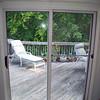 Before photo of sliding glass door.