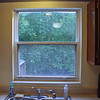Before photo above kitchen sink.