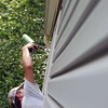Caulking the guest bedroom window.
