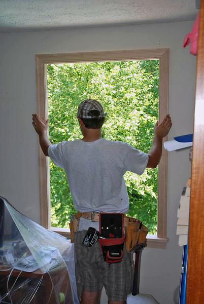 Installation of office window frame.