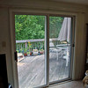 Before photo of sliding glass door.