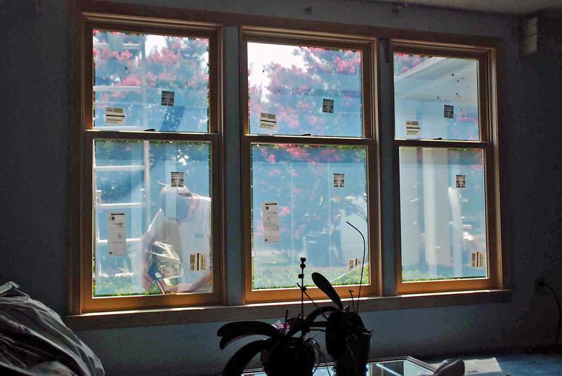 Caulking the exterior of the living room windows.