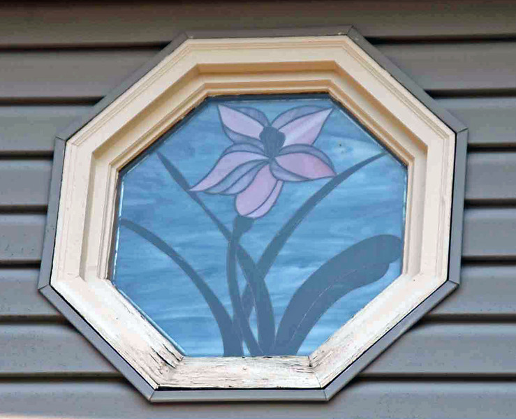 The master bath stained glass window frame had water damage on the outside of the frame.