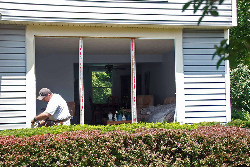 Preparing the outside of the living room windows.