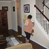Angie touching up the white trim color.  On the wall next to her are some of the colors we experimented with.