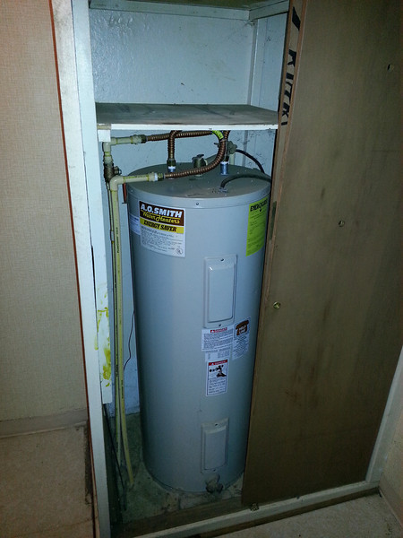 Before - Water Heater in Laundry Room Closet