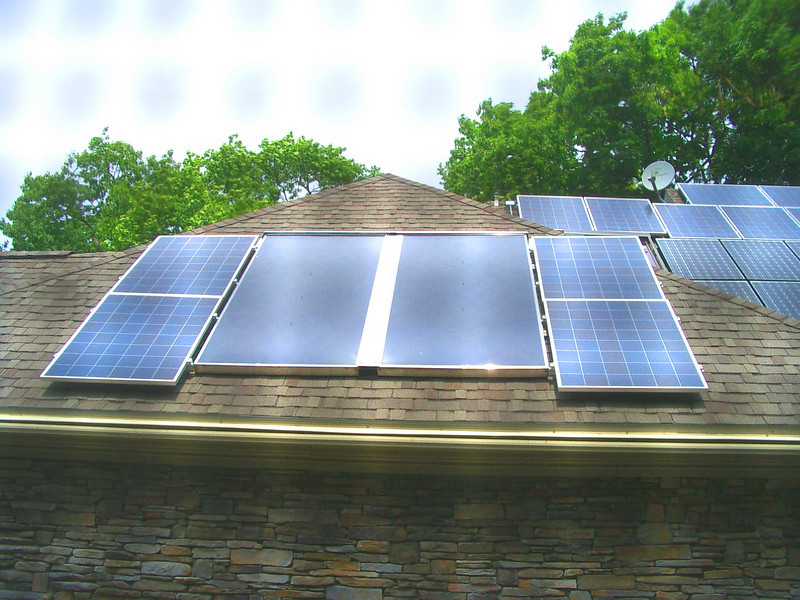 Enerworks solar thermal (hot water) panels flanked by PV panels.