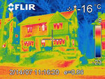 This is an infra-red image of our next door neighbours. Notice the difference in heat loss through the walls, as evidenced by the orange and red wall areas.