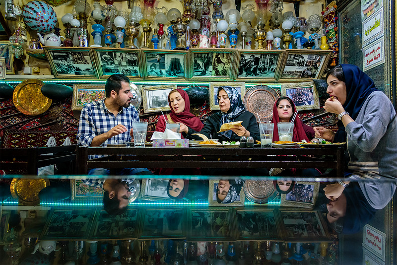 Young couple get acquainted with familymembers in the famous Azadegan teahouse, Isfahan