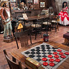 The Red Rose Saloon offers checkers, but the gunslinger is probably more interested in the saloon gal.