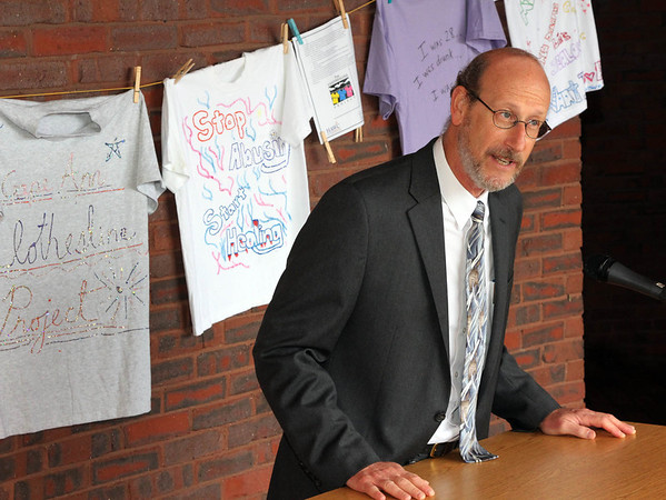 Allegra Boverman/Gloucester Daily Times. During the outdoor domestic violence awareness and recommitment ceremony held at the Gloucester Police Station on Tuesday to commemorate October as Domestic Violence Awareness Month and The Clothesline Project. Gloucester Schools Superintendent Dr. Richard Safier talked to the gathered audience,