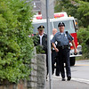 Allegra Boverman/Staff photo. Rockport Police Officer Roger Lesch, front right, walks with some of his department colleagues, with the Rockport Fire Department close behind, along his original foot patrol route in Rockport: Granite Pier to the former Cape Ann Tool Company building on Monday, his last day of fulltime work for the department. At left is Chief Tom McCarthy, behind them, Lt. Mark Schmink, along with others.