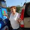 Allegra Boverman/Gloucester Daily Times. Donna Marchant of West Gloucester gives her opinion about gas prices at the Richdale Mobil gas station in Essex on Friday.