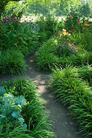 Crisscrossing pathways meander through one of the gardens.