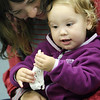 Allegra Boverman/Gloucester Daily Times. During the Audubon Ark program held at the Children's Library at the Sawyer Free Library on Wednesday morning, a duck named Paddy and a rabbit named Jasmine from Drumlin Farm in Lincoln paid a visit. Children learned about each animal's habits and characteristics. Looking at the skull of a duck are Mila Parsons, right, 14 months old, and her mom Agustina Parsons.
