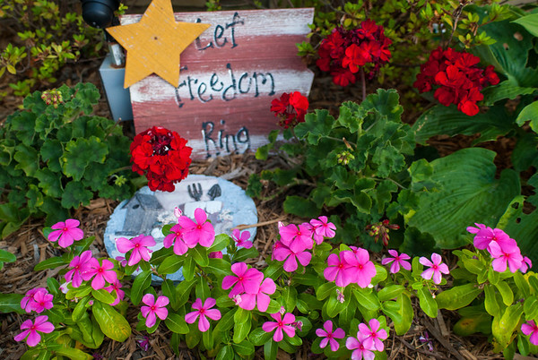 Alice Newell mixes garden art with the plantings.