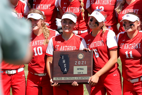 St. Anthony's Grace Karolewicz (left) and Laney Coffin (right) smile with the super-sectional plaque after winning the Class 1A Super-Sectionals against Marissa (Coulterville), Monday, June 14, 2021, at Johnston City High School, in Johnston City, Illinois. (Alex Wallner/Effingham Daily News)