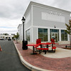 Allegra Boverman/Gloucester Daily Times. Five Guys Burgers and Fries in Gloucester Crossing abruptly closed at the end of business on Sunday. Employees were taking in the eatery's outdoor furniture at noon on Monday.