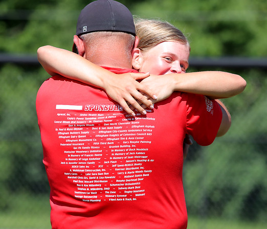 St. Anthony's Haley Niebrugge hugs a family member after winning the Class 1A Super-Sectionals against Marissa (Coulterville), Monday, June 14, 2021, at Johnston City High School, in Johnston City, Illinois. (Alex Wallner/Effingham Daily News)