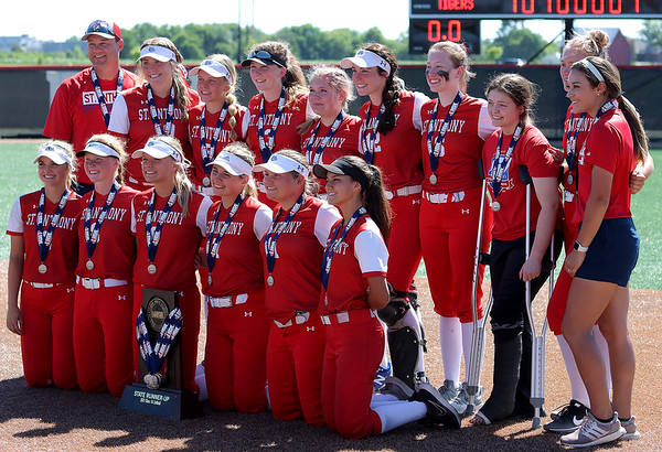 The St. Anthony Bulldogs pose for a picture with the state runner-up plaque after a softball game against Illini Bluffs in the Class 1A state championship game, Wednesday, June 16, 2021, at the Louisville Slugger Sports Complex in Peoria, Ill.