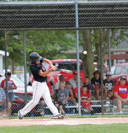 North Clay's Collyn Ballard hits the ball during a baseball game against Effingham (St. Anthony) in the Class 1A Sectional 6 Regional Finals on Monday, July 7, 2021, at Evergreen Hollow Park, in Effingham, Illinois. (Alex Wallner/Effingham Daily News)
