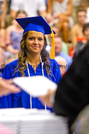 5-26-12   for the KT | Roger Davis<br /> Summer Tilley walks forward to receive her diploma during Commencement at Tipton High School.